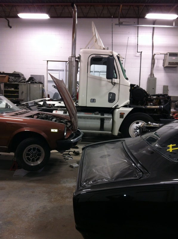 Side view of mac truck in shop